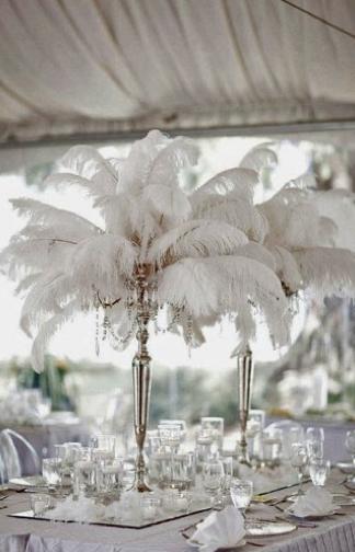 Dekoracija stolova sa perjem
